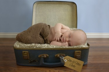 Baby asleep in a suitcase