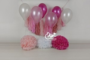 Pink balloons and tassels birthday backdrop