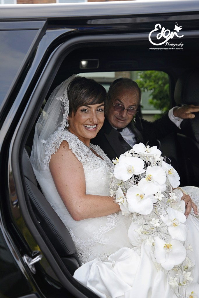 Bride in car with Fathers