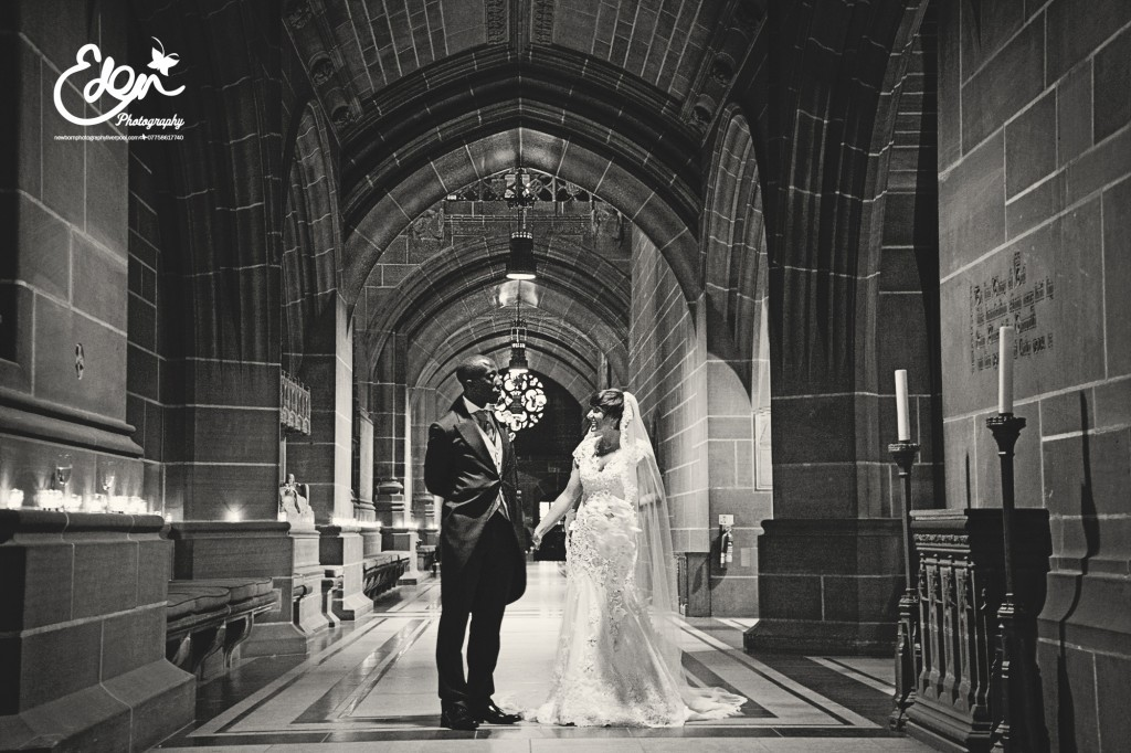 Bride and Groom look at each other in Liverpool Anglican Cathedral